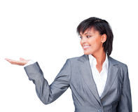 Smiling businesswoman showing a product Stock Image