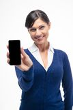 Smiling businesswoman showing smartphone screen Royalty Free Stock Photography