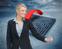 Smiling businesswoman showing something Royalty Free Stock Photography
