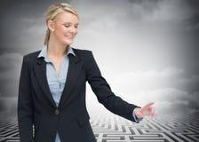 Smiling businesswoman showing something Stock Image