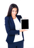 Smiling businesswoman showing tablet computer screen Royalty Free Stock Photos