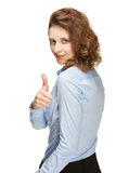 Smiling businesswoman showing thumb up sign Royalty Free Stock Photos
