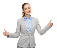Smiling businesswoman showing thumbs up Stock Images
