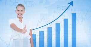 Smiling businesswoman showing thumbs up against graph. Digital composite of Smiling businesswoman showing thumbs up against graph Royalty Free Stock Image