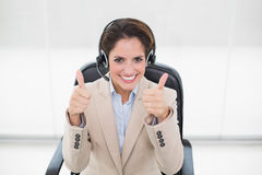 Smiling businesswoman showing thumbs up Stock Photos