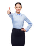 Smiling businesswoman showing thumbs up Stock Photography