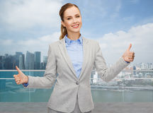 Smiling businesswoman showing thumbs up royalty free stock images