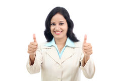 Smiling businesswoman showing thumbs up isolated against white b Royalty Free Stock Photos