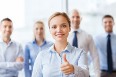 Smiling businesswoman showing thumbs up in office Royalty Free Stock Photo
