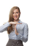 Smiling businesswoman. Showing timeout sign using her hands Royalty Free Stock Images