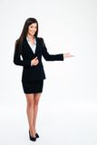 Smiling businesswoman showing welcome gesture Stock Image