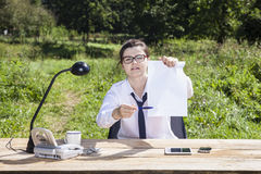 Smiling businesswoman showing where to sign Stock Photos