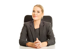 Smiling businesswoman sitting at the desk Stock Photos