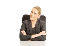 Smiling businesswoman sitting at the desk Stock Images