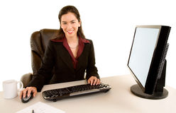 Smiling Businesswoman Sitting at her Desk Royalty Free Stock Photography