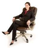 Smiling Businesswoman Sitting on a Leather Chair Royalty Free Stock Photos