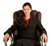Smiling Businesswoman Sitting on a Leather Chair Royalty Free Stock Images