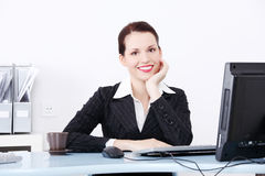 Smiling businesswoman sitting in the office. Stock Photography