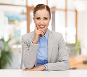 Smiling businesswoman sitting at table Royalty Free Stock Photography