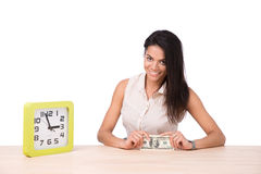 Smiling businesswoman sitting at the table with money Royalty Free Stock Image