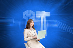Smiling businesswoman sitting and using laptop Stock Image