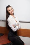 Smiling businesswoman sittng near board Stock Photos