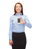Smiling businesswoman with smartphone blank screen Royalty Free Stock Images