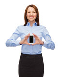 Smiling businesswoman with smartphone blank screen Stock Photo