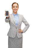 Smiling businesswoman with smartphone blank screen Stock Photography
