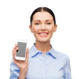 Smiling businesswoman with spartphone blank screen Royalty Free Stock Photos