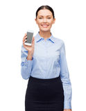 Smiling businesswoman with spartphone blank screen Royalty Free Stock Image