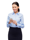 Smiling businesswoman with spartphone Royalty Free Stock Image