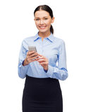 Smiling businesswoman with spartphone Stock Image