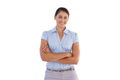 Smiling businesswoman standing alone with her arms crossed Stock Photo