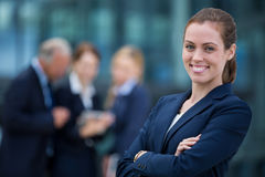 Smiling businesswoman standing with arms crossed Royalty Free Stock Photo