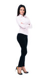 Smiling businesswoman standing with arms folded Royalty Free Stock Photos
