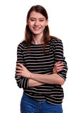 Smiling businesswoman, standing crossed arms - stock image Stock Photo