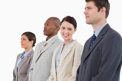 Smiling businesswoman standing between her colleagues Stock Photo