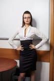 Smiling Businesswoman Standing Near Board Stock Photo