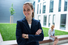 Smiling businesswoman standing in office premises. Portrait of smiling businesswoman standing in office premises Stock Images