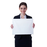 Smiling businesswoman standing over white isolated background Stock Photo