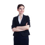 Smiling businesswoman standing over white isolated background Stock Images