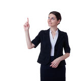 Smiling businesswoman standing over white isolated background Royalty Free Stock Images