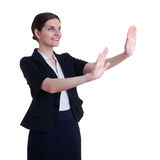 Smiling businesswoman standing over white isolated background Stock Photos