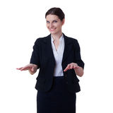 Smiling businesswoman standing over white isolated background Stock Photography