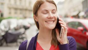 Smiling businesswoman standing on street talking on mobile. Professional female having business call. Positive businesswoman standing on street talking on stock video