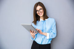Smiling businesswoman standing with tablet computer Stock Images