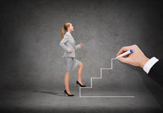 Smiling businesswoman stepping up staircase. Business and education concept - smiling businesswoman stepping up staircase Royalty Free Stock Image