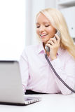 Smiling businesswoman or student calling on phone Royalty Free Stock Photos