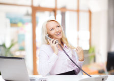 Smiling businesswoman or student calling on phone Royalty Free Stock Images